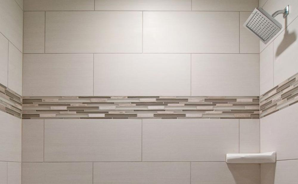 TILING IN NEW WALK IN SHOWER – Tim Co Plumbing